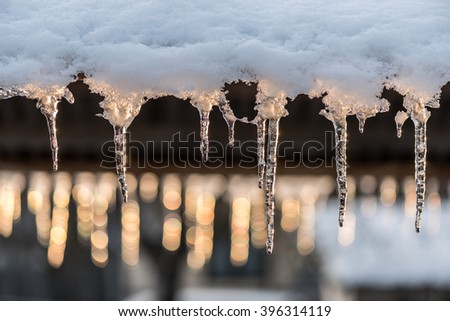 Icicles and shiny lights. Icicles in sunset. - stock photo