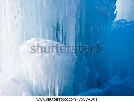 Icicles formation, from pure white into deep blue. - stock photo