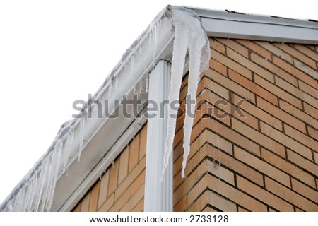icicles hanging on house in winter