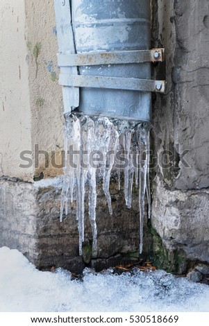 icicles hanging on the pipe, the concept of winter