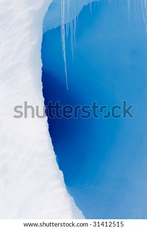icicles in a blue ice cave - stock photo