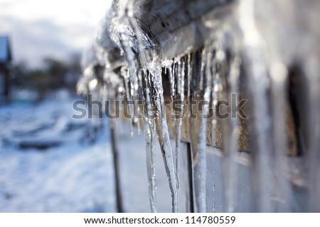 Icicles on a roof - stock photo