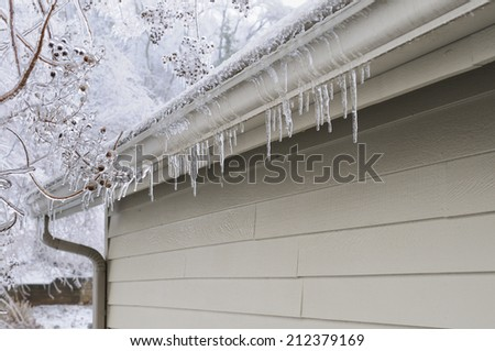 Icicles on House - stock photo