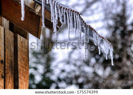 Icicles on outbuilding, West Virginia, USA - stock photo