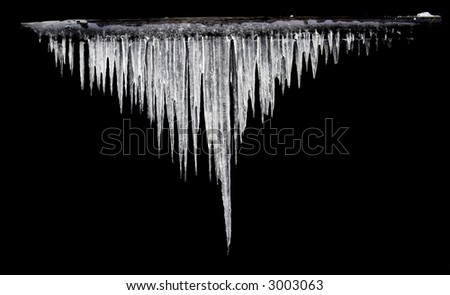 icicles on the black background isolated - stock photo