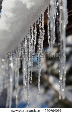 Icicles on the eaves. - stock photo