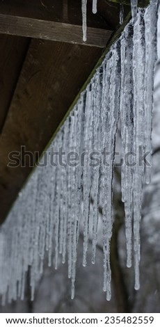 icicles on white,winter background - stock photo