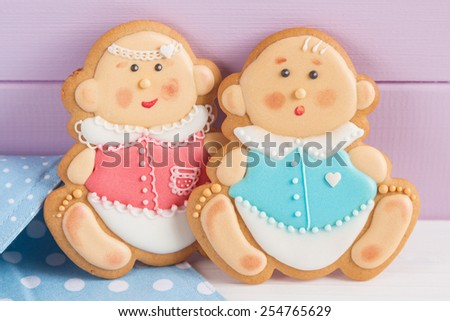 Icing cookies for baby shower party - stock photo