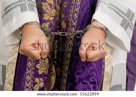 Icon image abuse in the church. Pastor handcuffed - stock photo