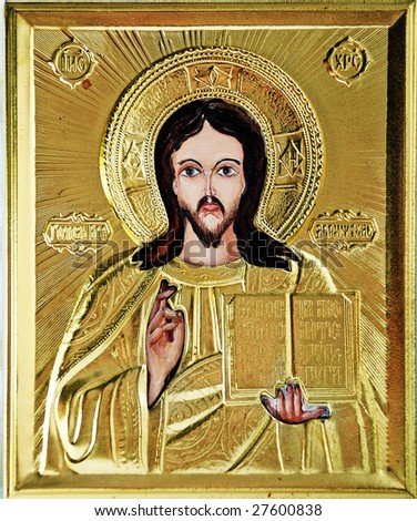 Icon, Jesus blesses and holds a book - stock photo