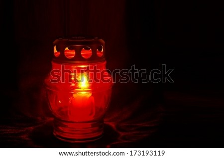 Icon lamp burning in the dark  - stock photo