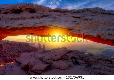 Iconic arching rock formation at dawn near Moab, Utah - stock photo