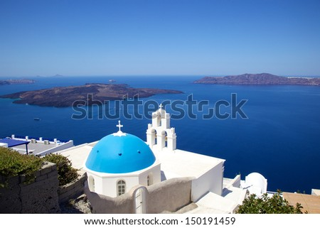 iconic blue dome church against blue sky beside Aegean sea on a Greek island, Santorini, Greece