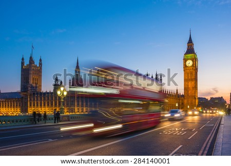 Iconic Double Decker bus with Big Ben and Parliament at blue hour, London, UK - stock photo