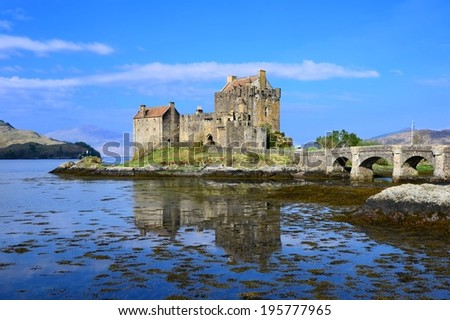 Iconic Eilean Donan Castle of Scotland with reflections - stock photo
