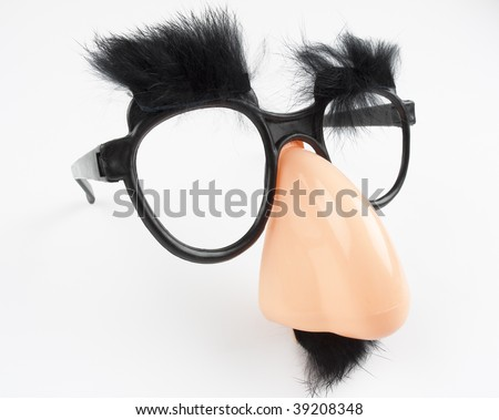 Iconic glasses disguise (object not copyrighted), with mustache, bushy eyebrows and big nose. Photographed with fisheye lens to exaggerate perspective. - stock photo