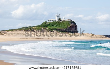 Iconic Nobbies Lighthouse at the entrance to Newcastle port in Australia - stock photo