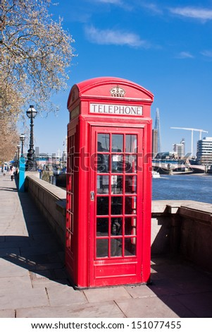 Iconic red phone booth in London - stock photo