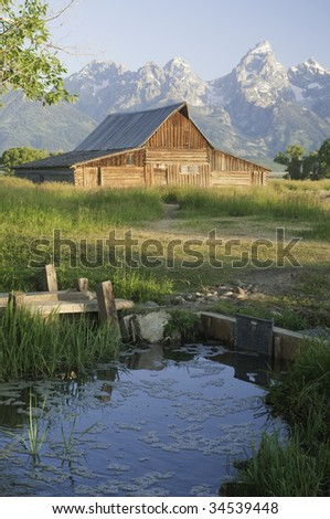 iconic scene of old Moulton Mormon wooden barn (circa 1880's) on Mormon Row in the Teton National park - stock photo