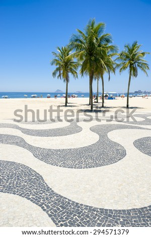 Iconic sidewalk tile pattern with palm trees at Copacabana Beach Rio de Janeiro Brazil - stock photo