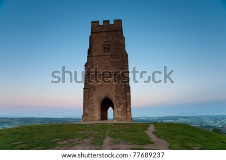Iconic St. Michael's Tower on top of Glastonbury Tor overlooking the town below.