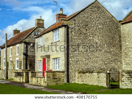 Iconic stone cottages in the village of Appleton le Moors, which is located in the North York Moors National Park, North Yorkshire, England  - stock photo