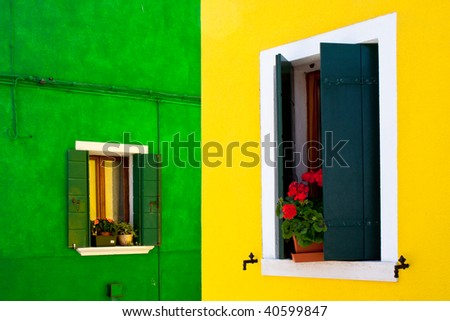 iconic venetian burano house with vibrant colour window and facade. Italy, Europe - stock photo