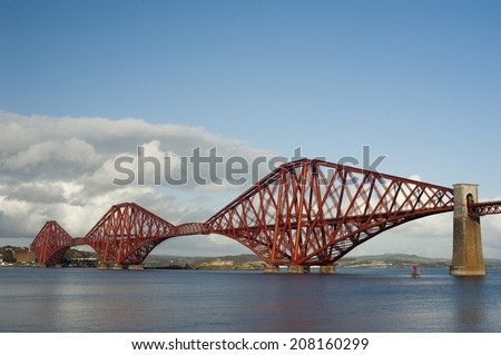 iconic victorian engineering allowing trains to cross over the firth of forth - stock photo
