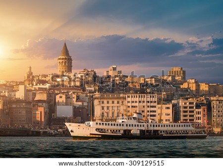 Iconic view of Istanbul with Galata Tower and the ferry - stock photo