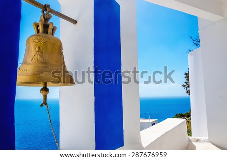 Iconic view on golden bell and typical blue-white church on Greek Island Kalymnos, Greece - stock photo
