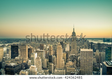Iconic vintage tone sunset view across New York City buildings from Midtown Manhattan