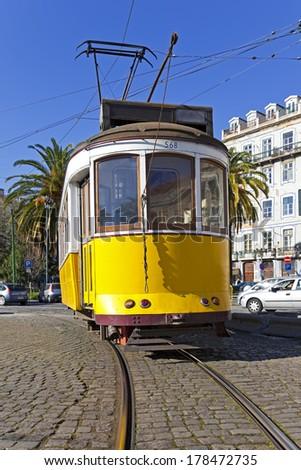 Iconic 100 year old Lisbon yellow tram. Lisbon, Portugal  - stock photo
