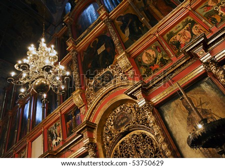 iconostasis Christian cathedral in the light of the lamps - stock photo