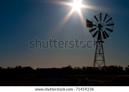Icons of the outback: Windmill silhouetted in afternoon light, Sturt National Park, outback NSW, Australia