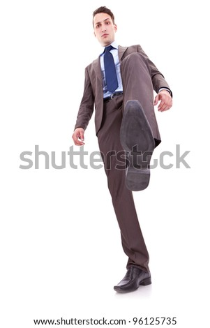 icture of a smiling business man stepping on something, over white - stock photo