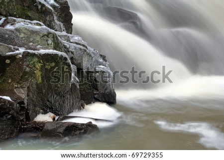 icy and mossy waterfall
