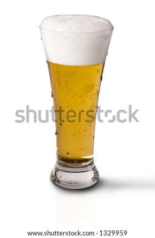 Icy cold frosty draft beer in glass - stock photo