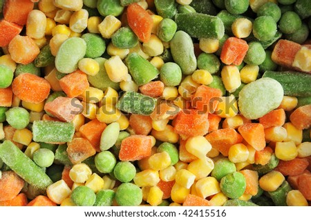 Icy cold frosty texture of vegetables. Close up. - stock photo