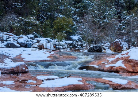Icy creek swollen with melting snow in Sedona, Arizona - stock photo