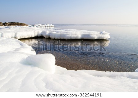 Icy floe, icy shore of the sea. North sea, the cold sea of the North, winter ice, white snow of the Arctic, Arctic ocean, beautiful  nature. Beach at the winter ocean. Spring Arctic. Melting of ice. - stock photo