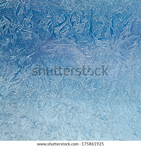 Icy pattern closeup in blue colors - stock photo