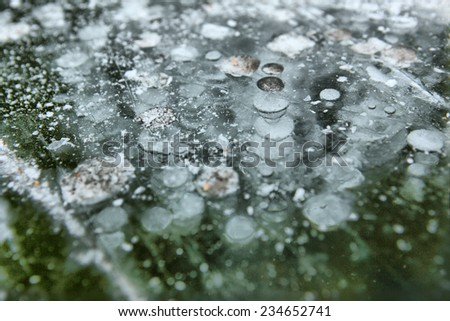 icy pond surface - stock photo
