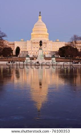 Icy reflection and the U.S. Capitol at sunset. Washington, DC - stock photo