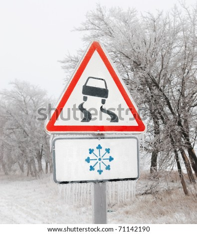 icy road sign - stock photo