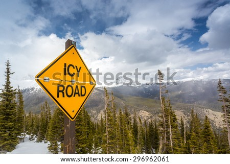 Icy Road Sign in Rocky Mountains National Park, Colorado, USA - stock photo