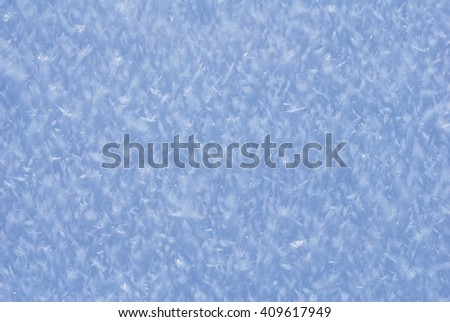 Icy snow snowflake crystal macro detail winter landscape ground detail snow magic background - stock photo