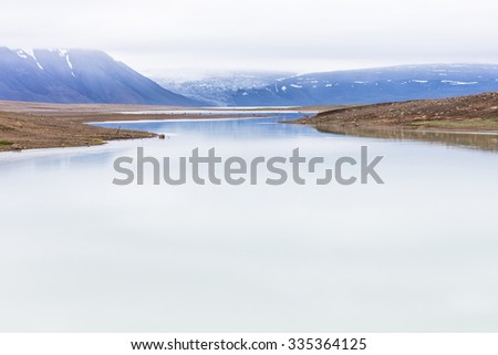 Icy water stream right after glacier! Melt away clear water stream. Somewhere in Iceland. - stock photo