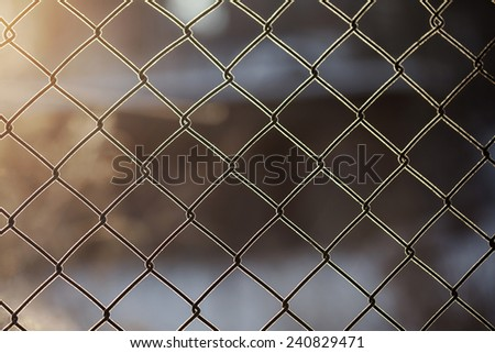 Icy wire mesh fence in winter - stock photo