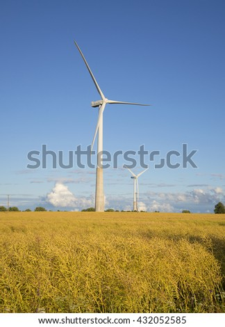 IDA-VIRUMAA, ESTONIA - AUGUST 01, 2015: Two wind electric generator on the summer field