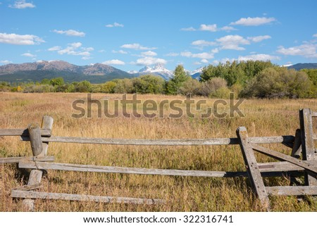 Idaho countryside with the Grand Teton mountain range in the distance. - stock photo